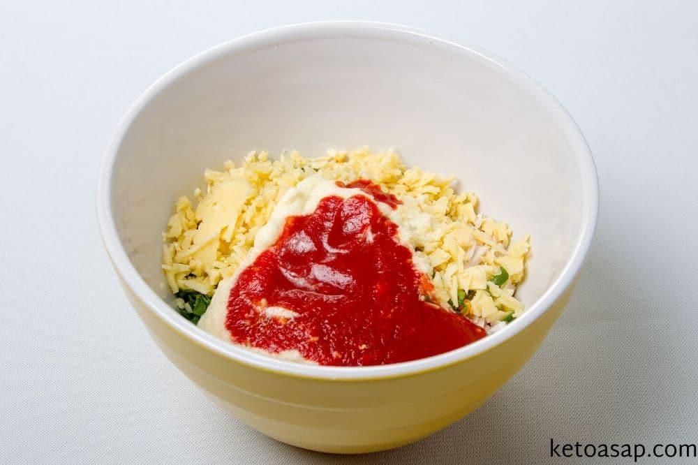 add chicken tomato paste sour cream chives cheddar cheese coriander