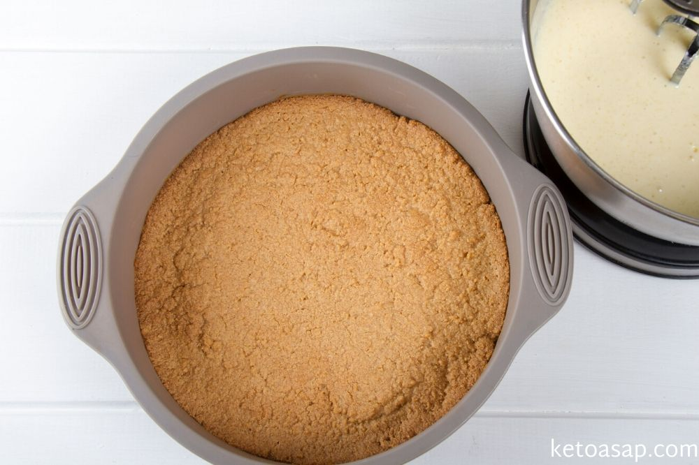 pour filling to almond cheesecake