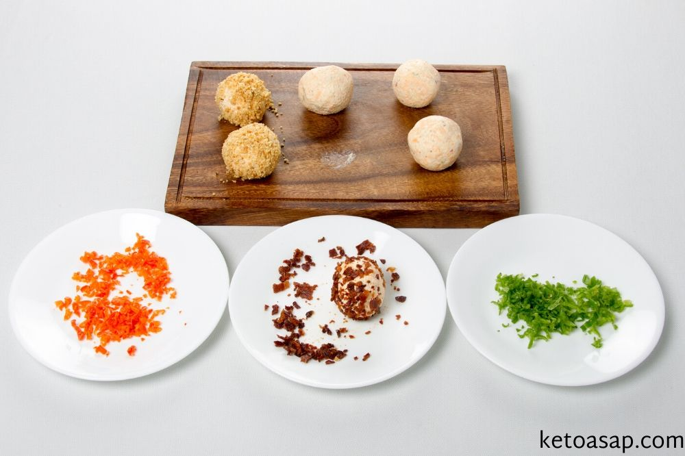 roll cheese balls on toppings