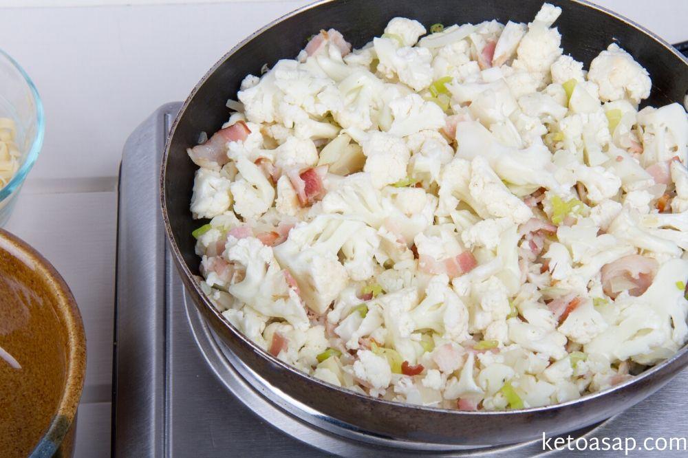 add cauliflower to vegetable mix