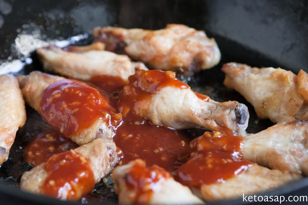 pour sauce on chicken wings