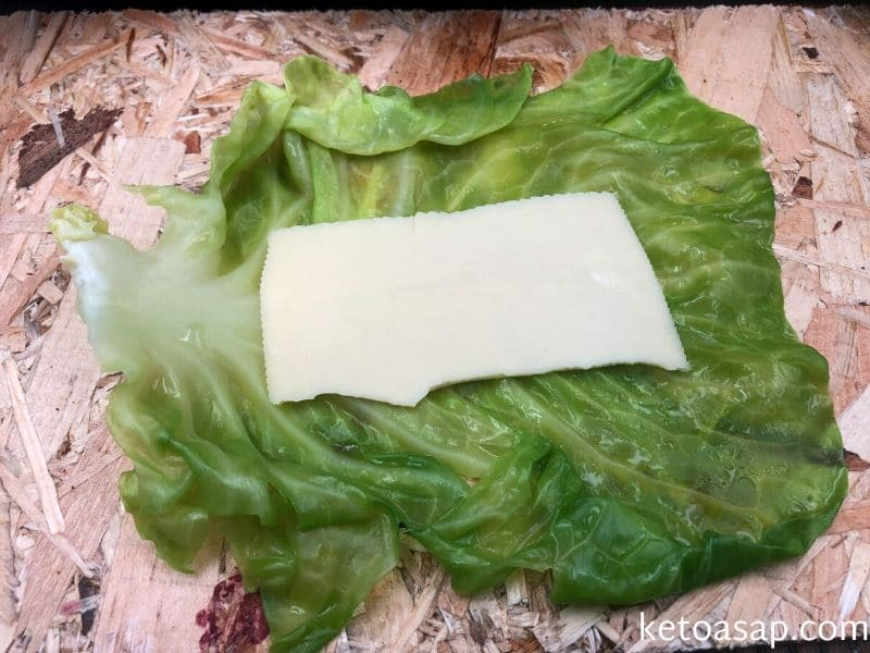 place gouda slice cabbage leaf