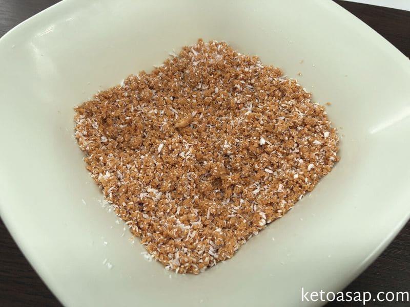 combine peanuts sweetener coconut flour cinnamon